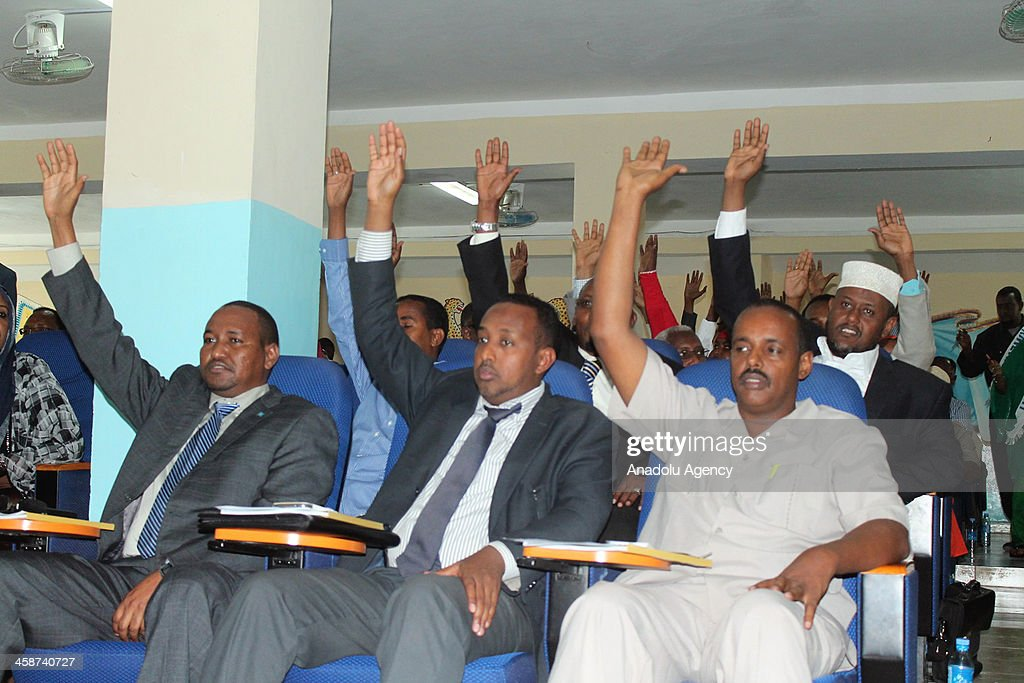 Lawmakers of the 275member parliament vote to give confidence to the premier on December 21 2013 in Mogadishu Somalia Abdiweli Sheikh Ahmed was sworn...