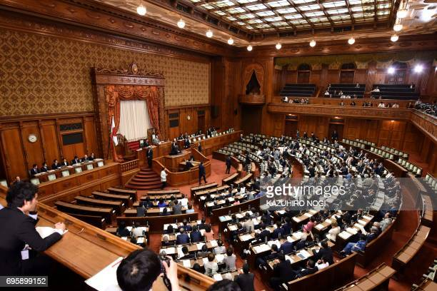 Lawmakers vote on a censure motion against Japan's Justice Minister Katsutoshi Kaneda during an upper house plenary session of parliament in Tokyo on...