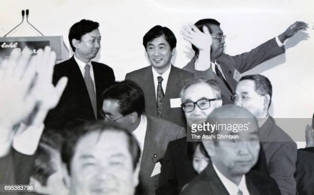 Lawmakers Yukio Hatoyama and Naoto Kan are seen during the ceremony to mark the foundation of the Democratic Party of Japan on September 28 1996 in...