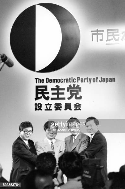 Lawmakers Yukio Hatoyama and Naoto Kan pose with election candidates during the ceremony to mark the foundation of the Democratic Party of Japan on...