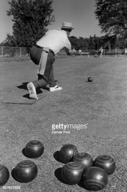 Lawn Bowler Floyd Grove Follows Through During Match At Washington Park The 'bowl' is flattened on one side and develops a curve as it slows down...