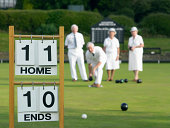 Lawn Bowling Scoreboard and People in the Background