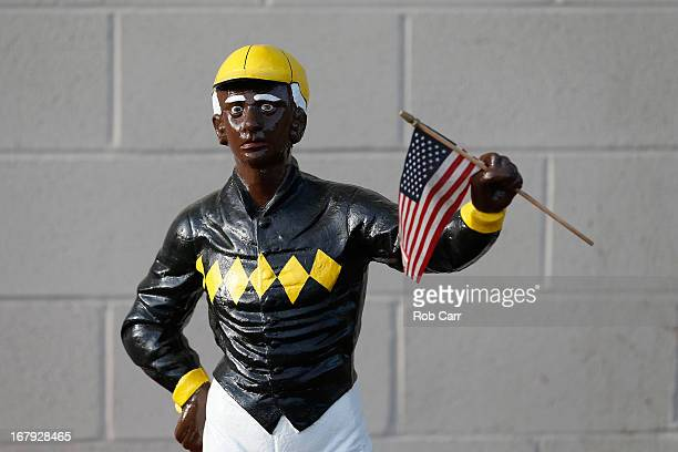 A lawn jockey statue with an American Flag is seen in the barn at Churchill Downs on May 2 2013 in Louisville Kentucky