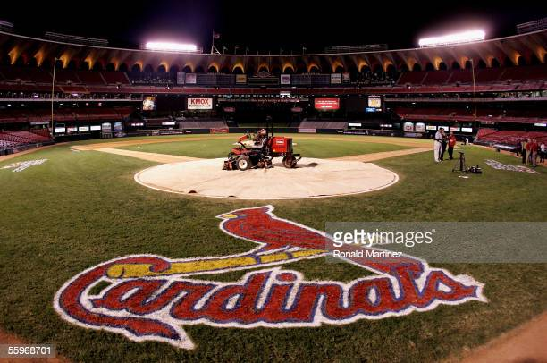 A lawn mower is shown on home plate with a tarp as fans leave the stands following the St Louis Cardinals 51 loss the Houston Astros during Game Six...