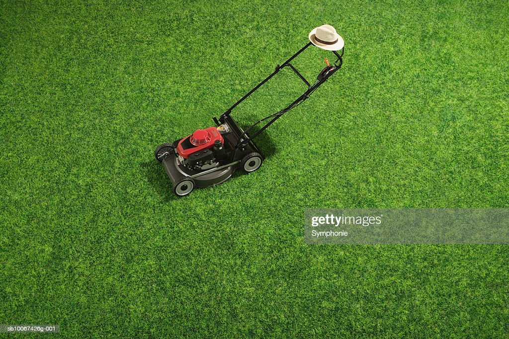 Lawn mower on grass, elevated view