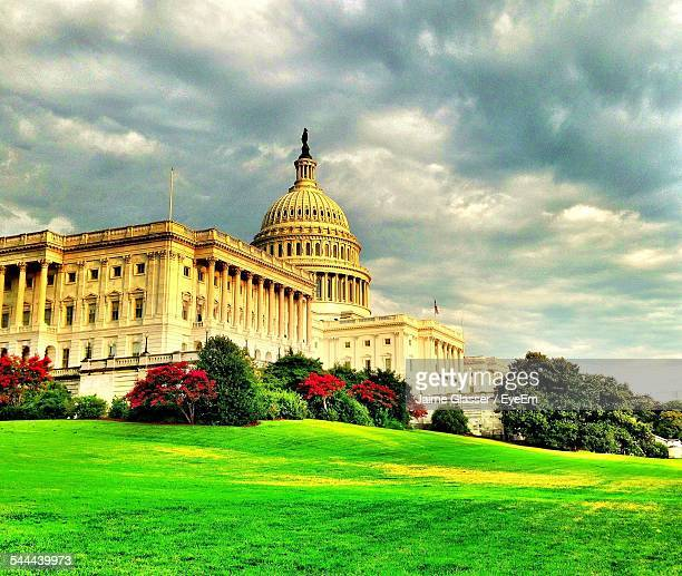Lawn Outside Capitol Building Against Cloudy Sky