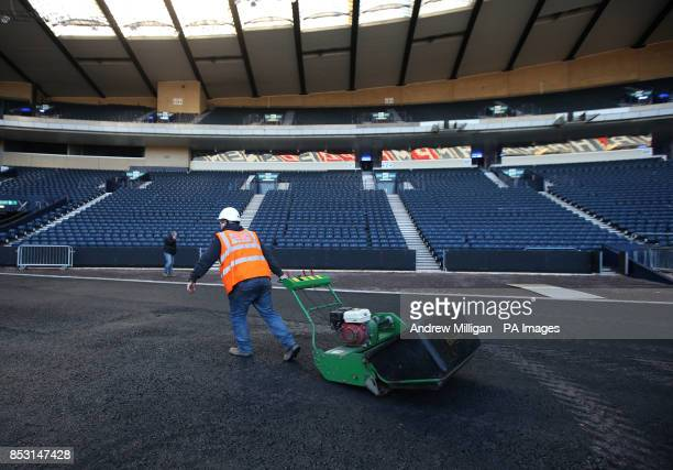 A lawnmower is moved on the new tarmac after the stadium surface was raised by almost two metres gaining the width and length required for an...