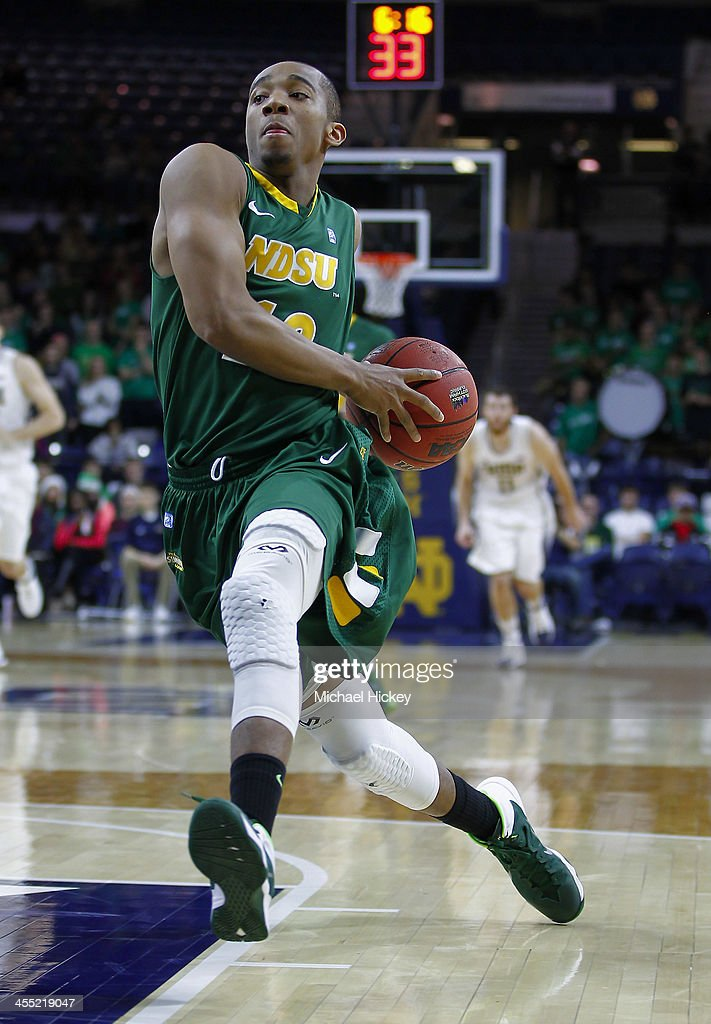 Lawrence Alexander #12 of the North Dakota State Bison drives to the basket during the game against the Notre Dame Fighting Irish at Purcel Pavilion on December 11, 2013 in South Bend, Indiana. North Dakota State defeated Notre Dame 73-69.