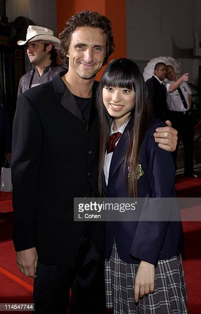 Lawrence Bender Producer and Chiaki Kuriyama during 'Kill Bill Vol 1' Premiere Red Carpet at Grauman's Chinese Theater in Hollywood California United...