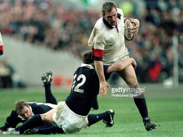 Lawrence Dallaglio of England is tackled by Ian Jardine of Scotland during their Five Nations rugby union match at Murrayfield in Edinburgh on 2nd...