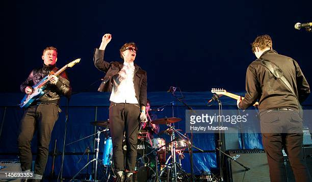Lawrence Diamond Tom Burke and Thom Roades of Citizens performs on stage during Field Day Festival at Victoria Park on June 2 2012 in London United...