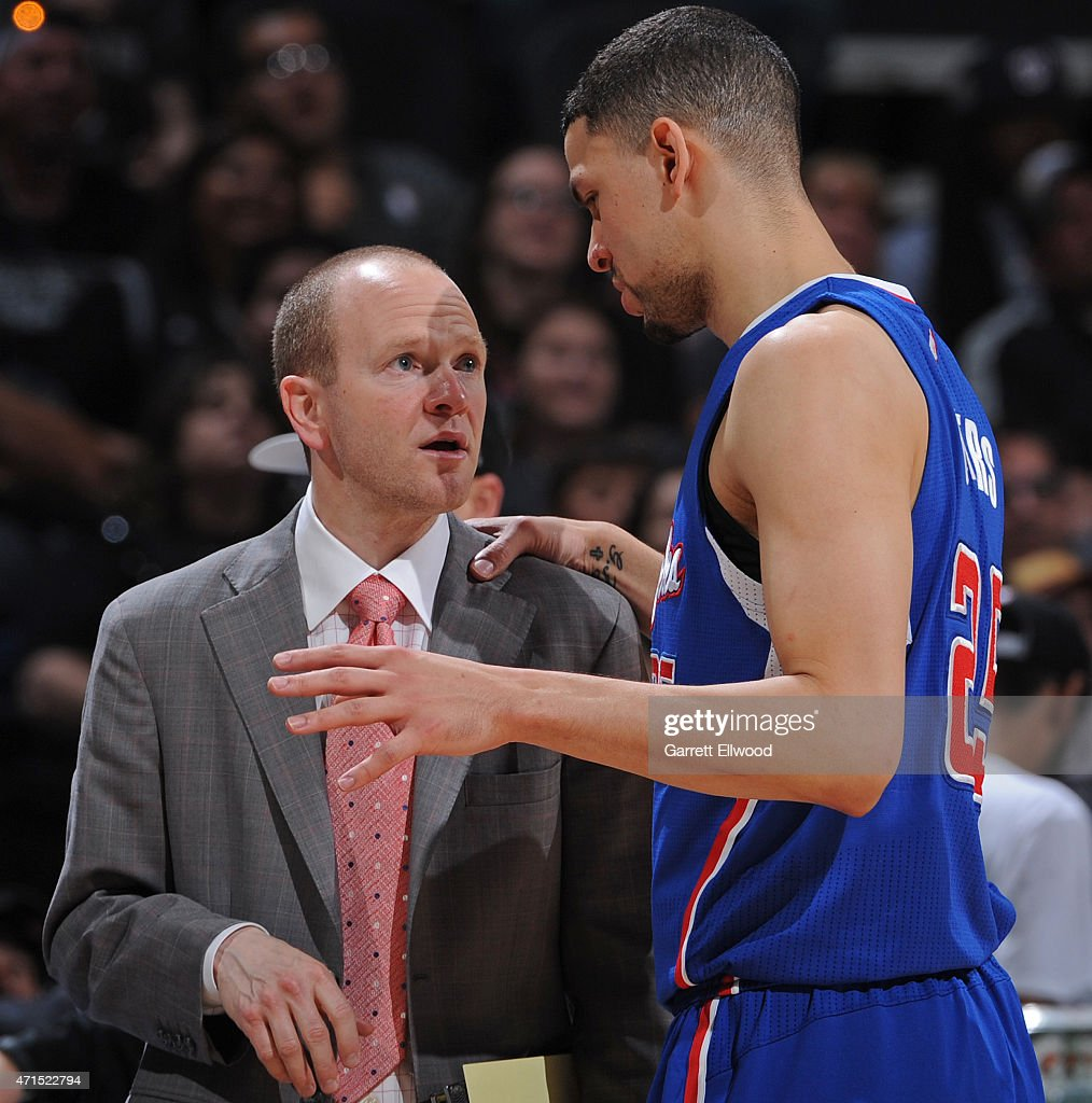 Lawrence Frank and Austin Rivers #25 of the Los Angeles Clippers talk in Game Four of the Western Conference Quarterfinals against the San Antonio Spurs during the 2015 NBA Playoffs on April 26, 2015 at the AT&T Center in San Antonio, Texas.