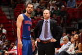 Lawrence Frank Head Coach of the Detroit Pistons shares a word with Jose Calderon during the game against the Miami Heat on March 22 2013 at American...
