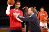 Lawrence Frank Head Coach of the Detroit Pistons talks to Jose Calderon of the Detroit Pistons before a game played against the New York Knicks on...