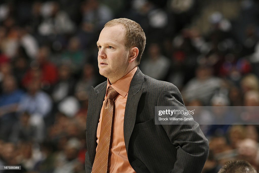 Lawrence Frank of the Detroit Pistons looks on from the bench during the game against the Charlotte Bobcats at the Time Warner Cable Arena on March...
