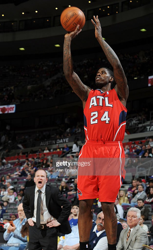Lawrence Frank of the Detroit Pistons reacts as Marvin Williams of the Atlanta Hawks takes a jump shot during the game on March 9 2012 at The Palace...