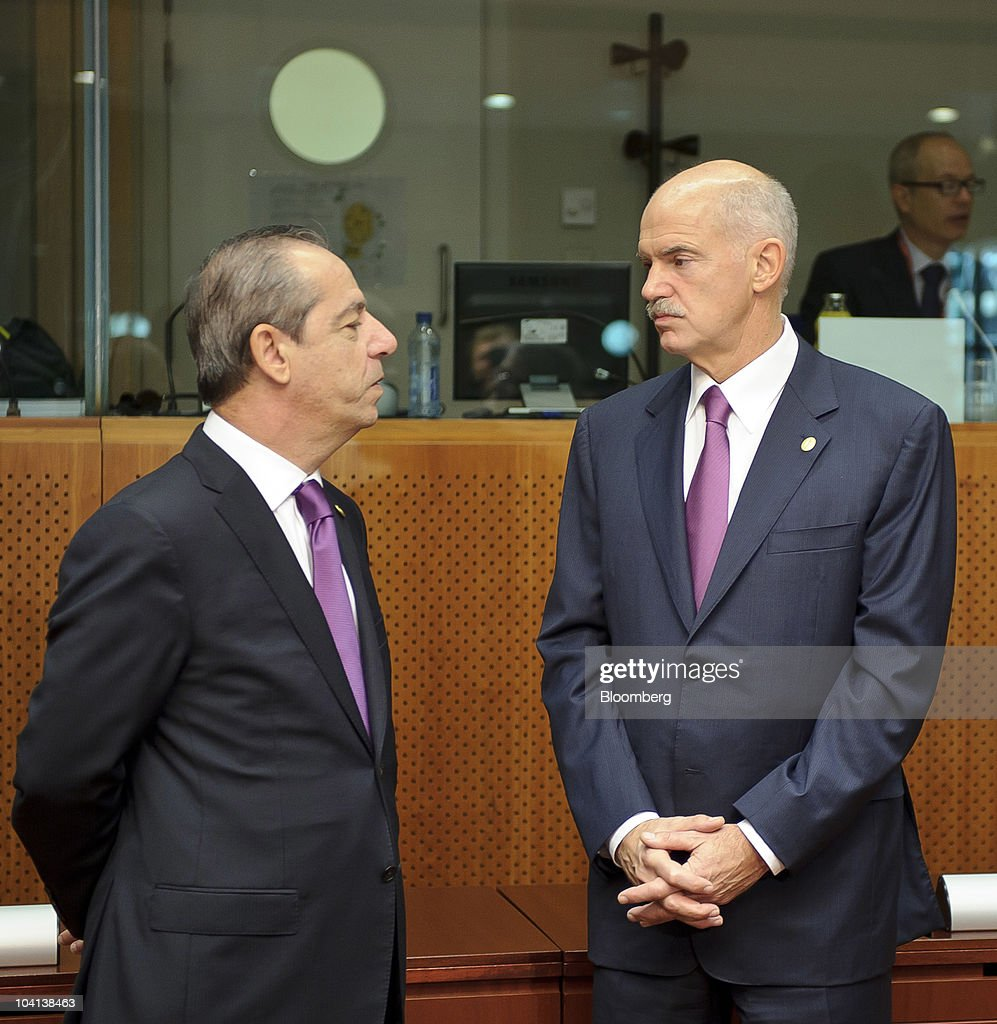 Lawrence Gonzi Malta's prime minister left speaks with George Papandreou Greece's prime minister during the European Union summit meeting at the...
