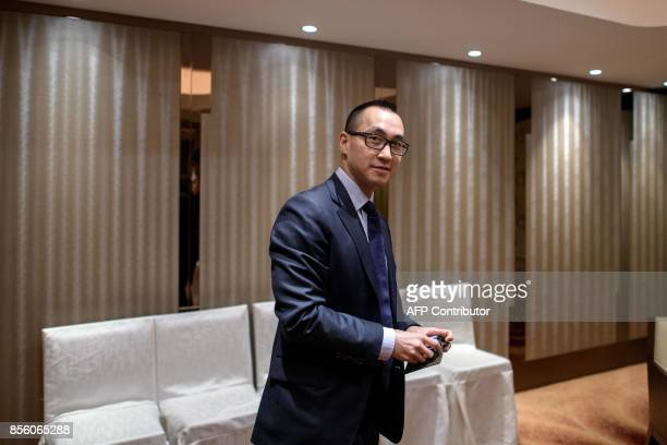 Lawrence Ho chairman and chief executive officer of Melco Resorts and Entertainment Ltd reacts before an interview with AFP Hong Kong on September 27...