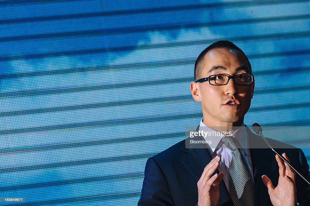 Lawrence Ho, co-chairman and chief executive officer of Melco Crown Entertainment Ltd., gestures as he speaks during a news conference in Manila, the Philippines, on Wednesday, Oct. 9, 2013. Ho said gambling revenue in the Philippines 'could easily' double to $4 billion in a couple of years, setting the stage to challenge Singapore as Asia's second-biggest gaming hub. Photographer: Julian Abram Wainwright/Bloomberg via Getty Images