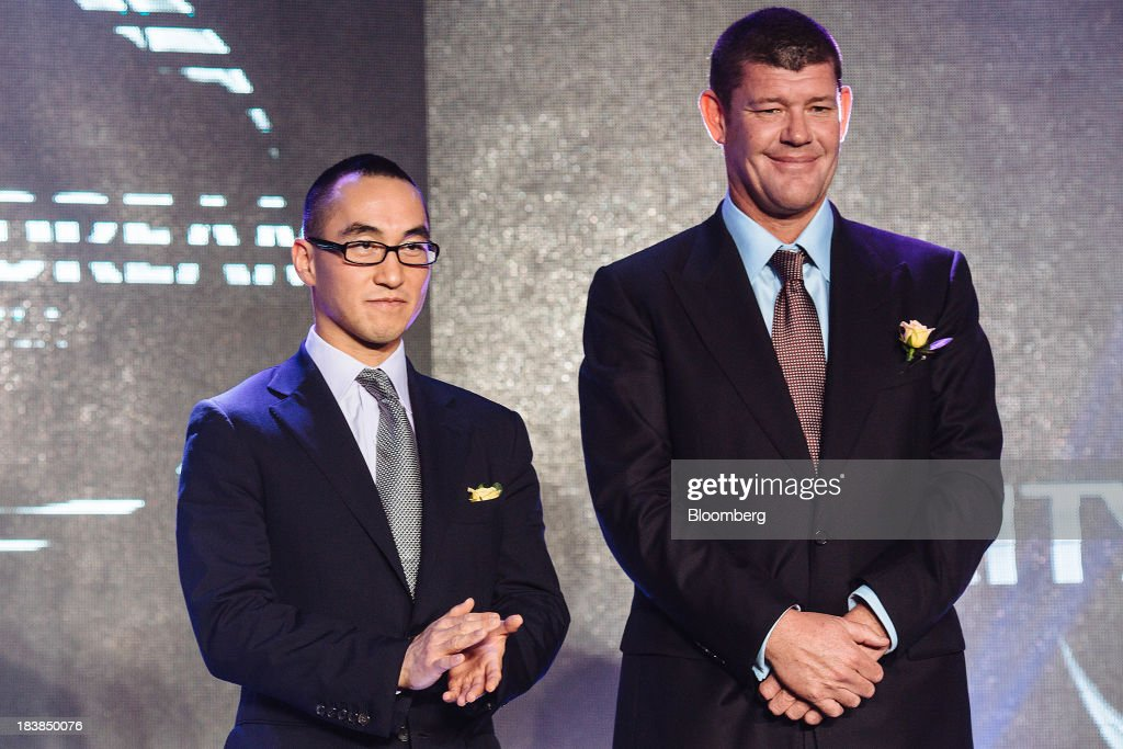 Lawrence Ho, co-chairman and chief executive officer of Melco Crown Entertainment Ltd., left, and <a gi-track='captionPersonalityLinkClicked' href=/galleries/search?phrase=James+Packer&family=editorial&specificpeople=208645 ng-click='$event.stopPropagation()'>James Packer</a>, co-chairman of Melco Crown Entertainment Ltd. and chairman of Crown Ltd., pose for a photograph during a news conference in Manila, the Philippines, on Wednesday, Oct. 9, 2013. Ho said gambling revenue in the Philippines 'could easily' double to $4 billion in a couple of years, setting the stage to challenge Singapore as Asia's second-biggest gaming hub. Photographer: Julian Abram Wainwright/Bloomberg via Getty Images