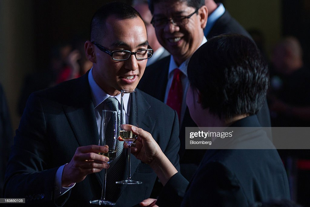Lawrence Ho, co-chairman and chief executive officer of Melco Crown Entertainment Ltd., left, toasts with Teresita Sy-Coson, vice chairwoman of SM Investments Corp., during a news conference in Manila, the Philippines, on Wednesday, Oct. 9, 2013. Ho said gambling revenue in the Philippines 'could easily' double to $4 billion in a couple of years, setting the stage to challenge Singapore as Asia's second-biggest gaming hub. Photographer: Julian Abram Wainwright/Bloomberg via Getty Images