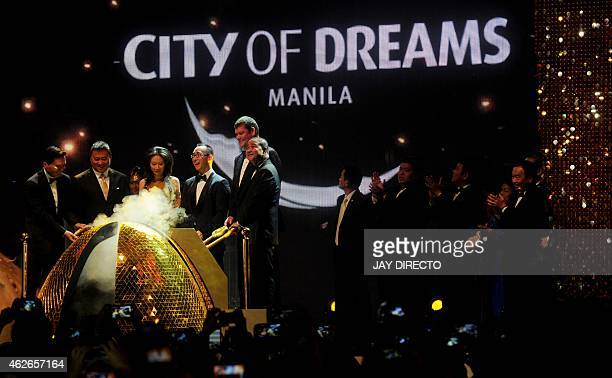Lawrence Ho with his wife Sharen son of Macau gaming tycoon Stanley Ho and cochairman of Melco crown and his co chairman Australian billionaire James...