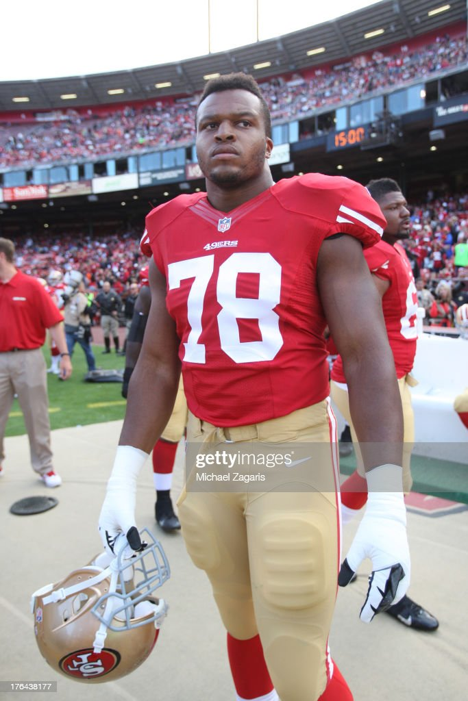 Lawrence Okoye #78 of the San Francisco 49ers stands on the sideline prior to the game against the Denver Broncos at Candlestick Park on August 8, 2013 in San Francisco, California. The Broncos defeated the 49ers 10-6.