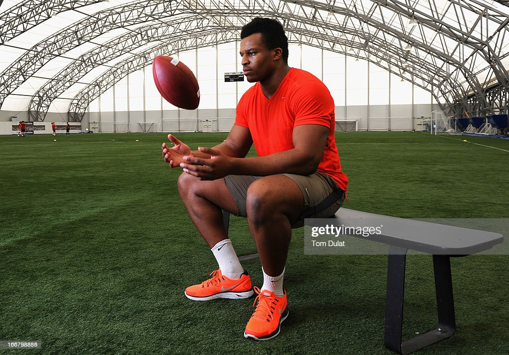 Lawrence Okoye poses for photographs during the NFL Media Day at The London Soccerdome on April 17, 2013 in London, England.