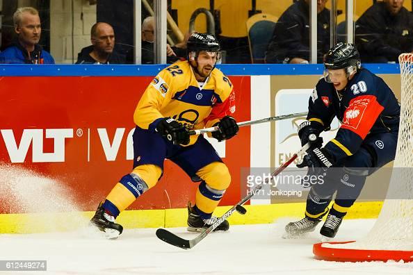 Lawrence Pilut of HV71 Jonkoping challenges Toni Koivisto of Lukko Rauma during the Champions Hockey League Round of 32 match between HV71 Jonkoping...