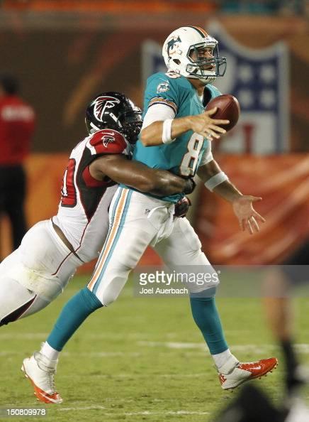 Lawrence Sidbury of the Atlanta Falcons sacks Matt Moore of the Miami Dolphins causing a fumble during a preseason game on August 24 2012 at Sun Life...