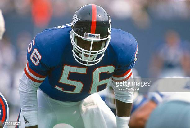 Lawrence Taylor of the New York Giants in action against the Dallas Cowboys during an NFL football game September 30 1990 at The Meadowlands in East...