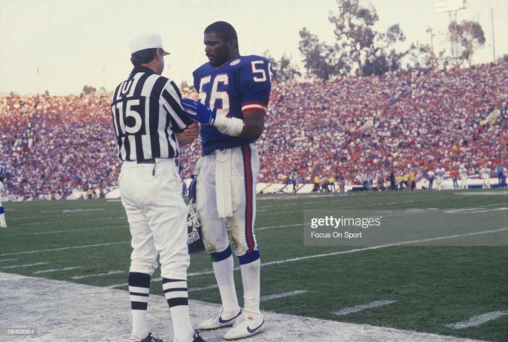 Lawrence Taylor #56 of the New York Giants talks to a referee on the sidelines during Super Bowl XXI against the Denver Broncos at the Rose Bowl on January 25, 1987 in Passadena, California. The Giants defeated the Broncos 39-20.