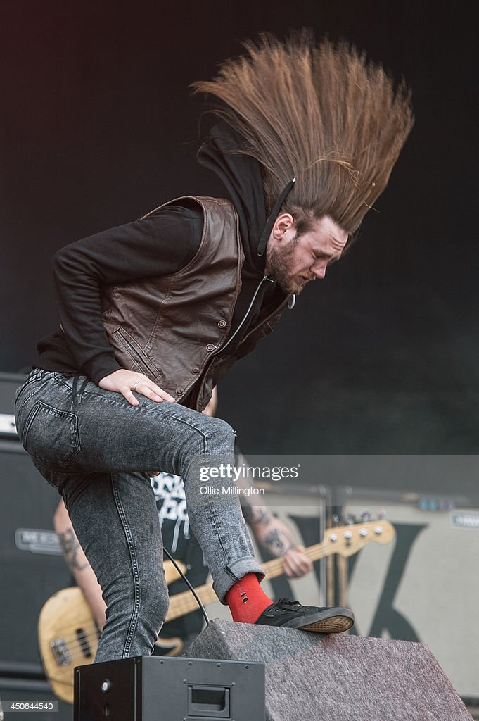 <a gi-track='captionPersonalityLinkClicked' href=/galleries/search?phrase=Lawrence+Taylor+-+Singer&family=editorial&specificpeople=15133624 ng-click='$event.stopPropagation()'>Lawrence Taylor</a> of While She Sleeps performs on stage at Download Festival at Donnington Park on June 14, 2014 in Donnington, United Kingdom.