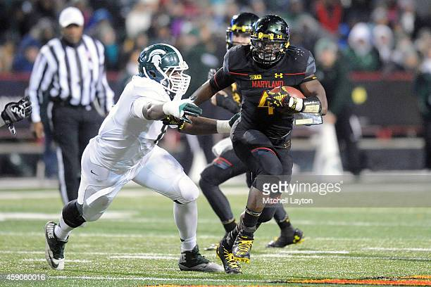 Lawrence Thomas of the Michigan State Spartans tries to tackle Wes Brown of the Maryland Terrapins during a college football game at Byrd Stadium on...