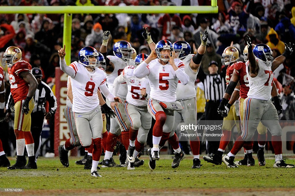 <a gi-track='captionPersonalityLinkClicked' href=/galleries/search?phrase=Lawrence+Tynes&family=editorial&specificpeople=966003 ng-click='$event.stopPropagation()'>Lawrence Tynes</a> #9 and Steve Weatherford #5 of the New York Giants celebrate after Tynes kicked a game-winning 31-yard field goal in overtime to win 20-17 against the San Francisco 49ers during the NFC Championship Game at Candlestick Park on January 22, 2012 in San Francisco, California.