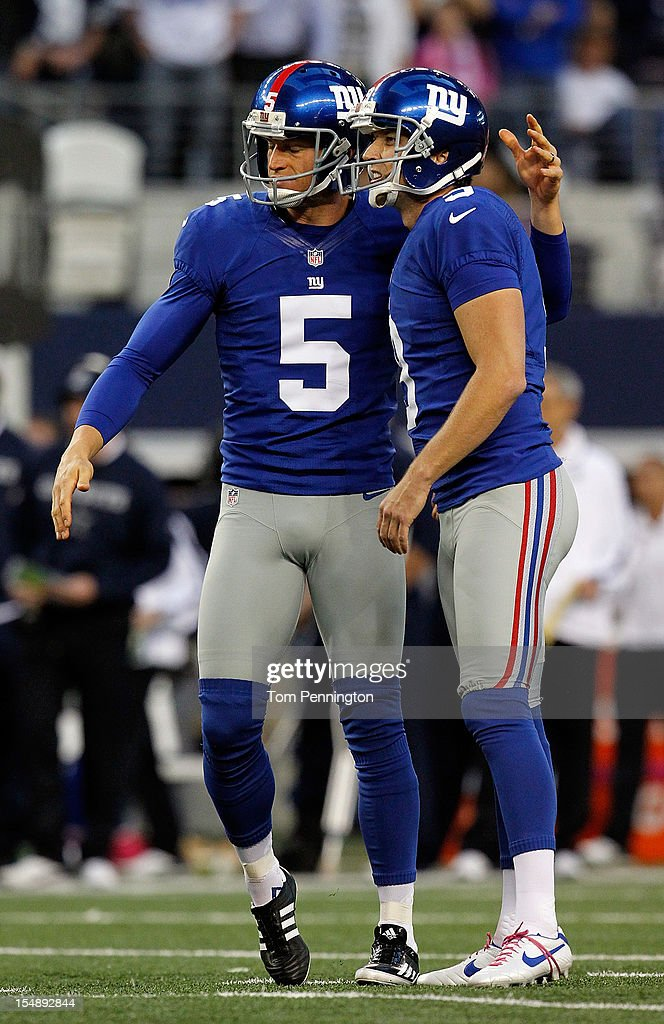 <a gi-track='captionPersonalityLinkClicked' href=/galleries/search?phrase=Lawrence+Tynes&family=editorial&specificpeople=966003 ng-click='$event.stopPropagation()'>Lawrence Tynes</a> #9 of the New York Giants celebrates with <a gi-track='captionPersonalityLinkClicked' href=/galleries/search?phrase=Steve+Weatherford&family=editorial&specificpeople=980653 ng-click='$event.stopPropagation()'>Steve Weatherford</a> #5 of the New York Giants after kicking a field goal at Cowboys Stadium on October 28, 2012 in Arlington, Texas. The New York Giants beat the Dallas Cowboys 29-26.