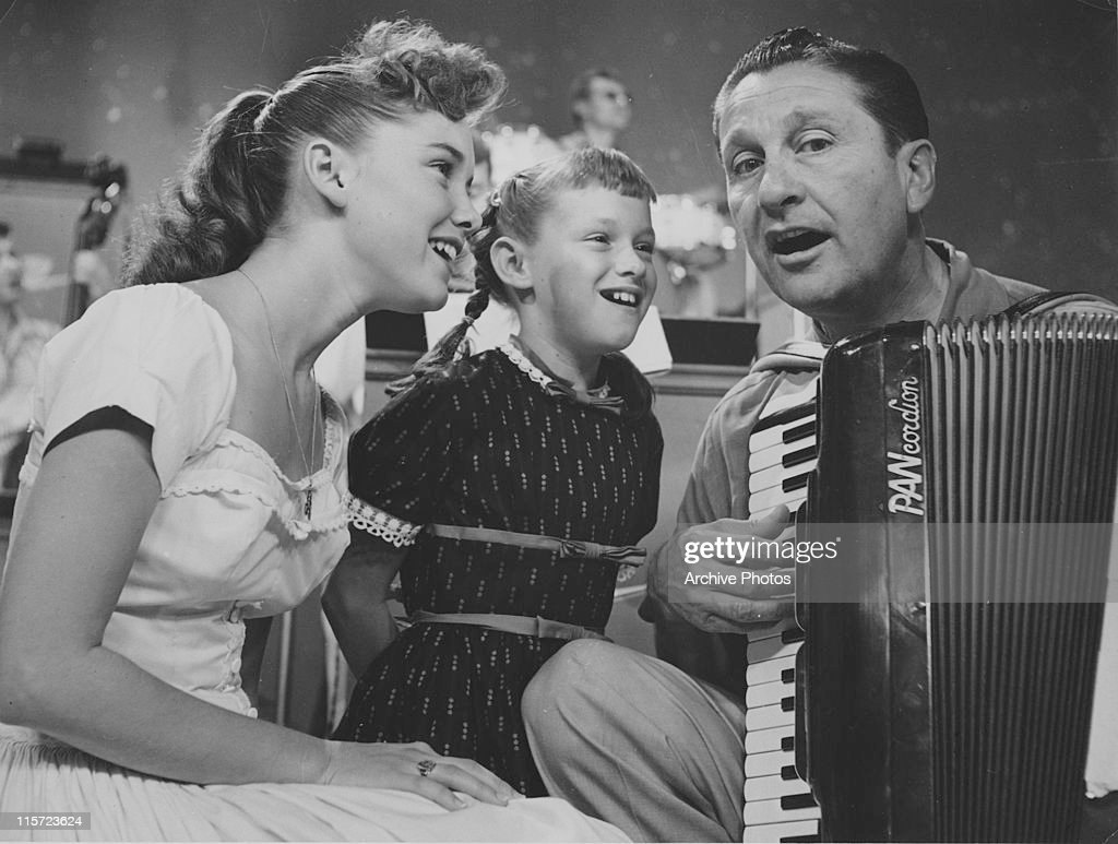 <a gi-track='captionPersonalityLinkClicked' href=/galleries/search?phrase=Lawrence+Welk&family=editorial&specificpeople=714731 ng-click='$event.stopPropagation()'>Lawrence Welk</a> (1903-1992), US musician and band leader, playing the accordion with sisters Dianne Lennon (left) and Janet Lennon, both of the 'Lennon Sisters', singing beside him, USA, circa 1955. The 'Lennon Sisters', a four-piece vocal group, were regulars on 'The <a gi-track='captionPersonalityLinkClicked' href=/galleries/search?phrase=Lawrence+Welk&family=editorial&specificpeople=714731 ng-click='$event.stopPropagation()'>Lawrence Welk</a> Show', which ran from 1955 to 1982.