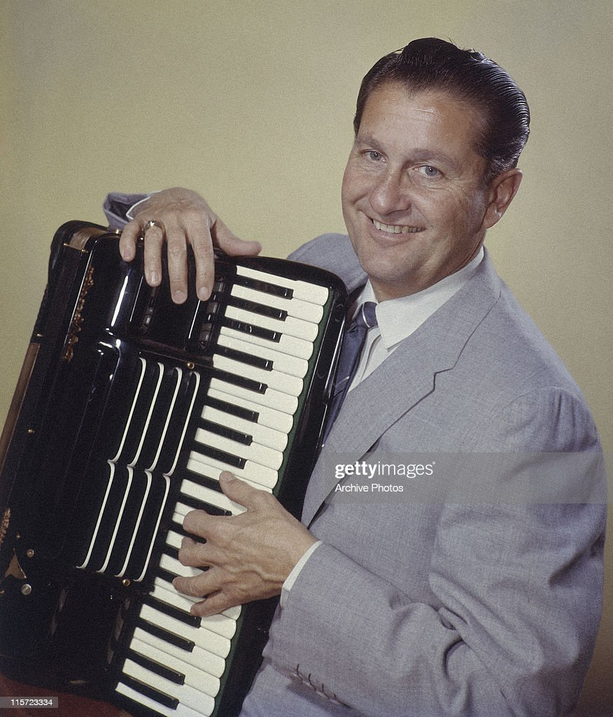 <a gi-track='captionPersonalityLinkClicked' href=/galleries/search?phrase=Lawrence+Welk&family=editorial&specificpeople=714731 ng-click='$event.stopPropagation()'>Lawrence Welk</a> (1903-1992), US musician and band leader, smiling while posing with an accordian, circa 1955.