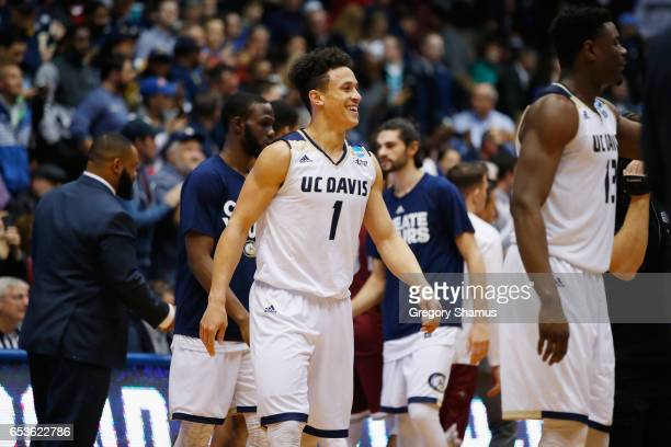 Lawrence White of the UC Davis Aggies reacts with teammates after defeating the North Carolina Central Eagles 6763 during the First Four game in the...