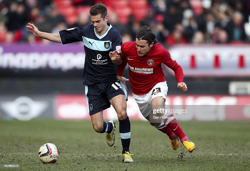 Lawrie Wilson of Charlton battles with Alex Kacaniklic of Burnley during the npower Championship match between Charlton Athletic and Burnley at the Valley on March 02, 2013 in London, England.