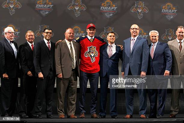Lawson Crouse 11th overall selection by the Florida Panthers stands onstage with the Florida Panthers organizational staff during Round One of the...