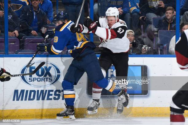 Lawson Crouse of the Arizona Coyotes checks Ivan Barbashev of the St Louis Blues on March 27 2017 at Scottrade Center in St Louis Missouri