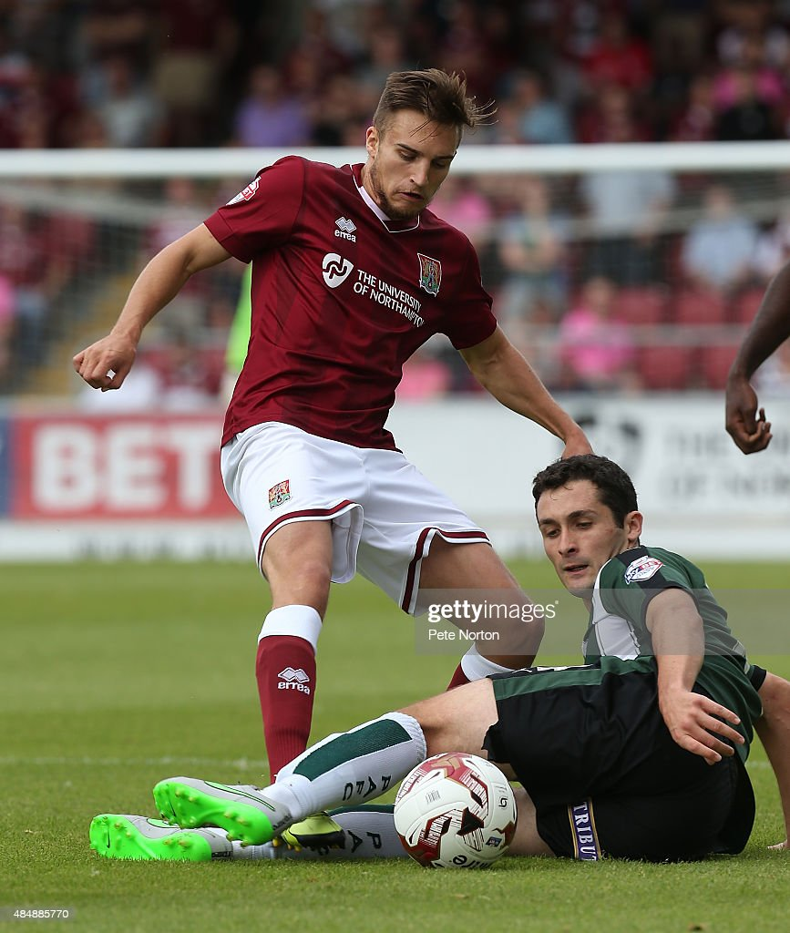 Lawson D'Ath of Northampton Town contests the ball with Carl McHugh of Plymouth Argyle during the Sky Bet League Two match between Northampton Town and Plymouth Argyle at Sixfields Stadium on August 22, 2015 in Northampton, England.