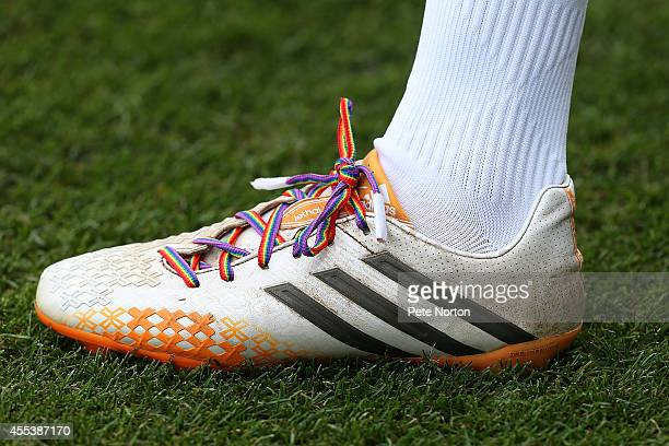 Lawson D'Ath of Northampton Town wears Rainbow laces as part of a antihomophobia campain during the Sky Bet League Two match between Newport County...