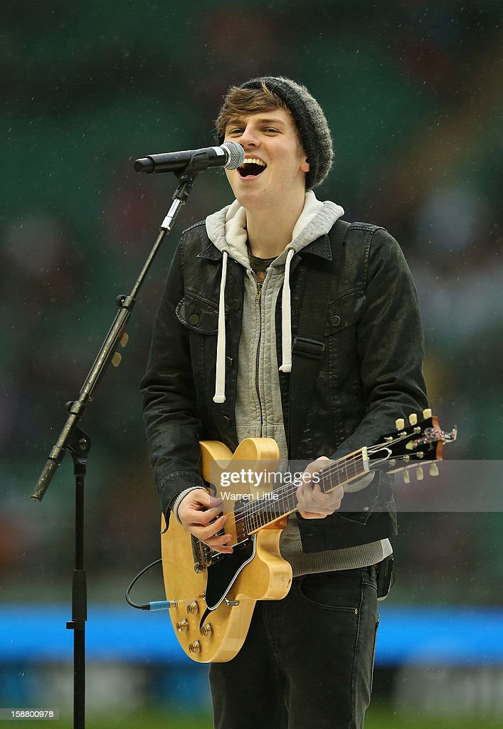 Lawson guitarist Joel Peat performs prior to the Aviva Premiership match between Harlequins and London Irish at Twickenham Stadium on December 29, 2012 in London, England.