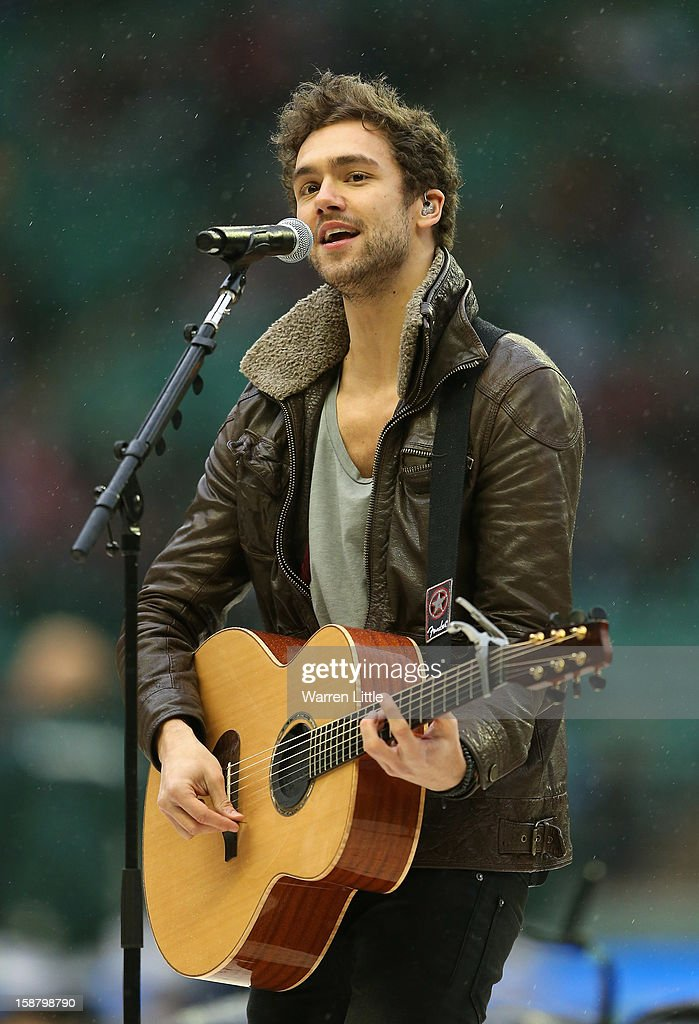 Lawson lead singer Andy Brown performs prior to the Aviva Premiership match between Harlequins and London Irish at Twickenham Stadium on December 29, 2012 in London, England.