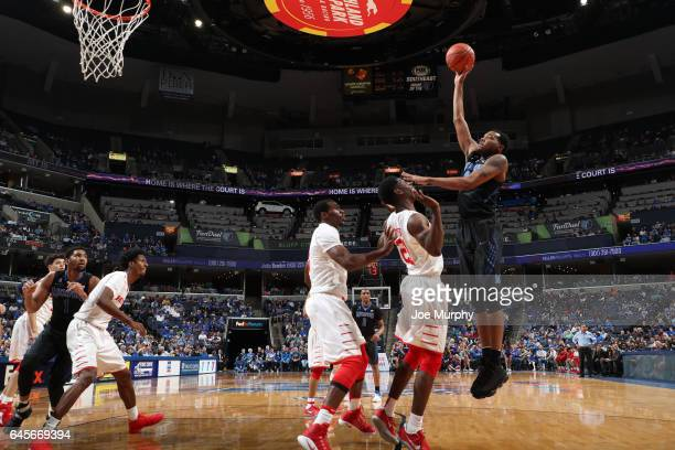 J Lawson of the Memphis Tigers shoots against Damyean Dotson of the Houston Cougars on February 26 2017 at FedExForum in Memphis Tennessee Houston...