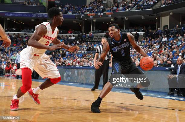J Lawson of the Memphis Tigers steps back against Damyean Dotson of the Houston Cougars on February 26 2017 at FedExForum in Memphis Tennessee...