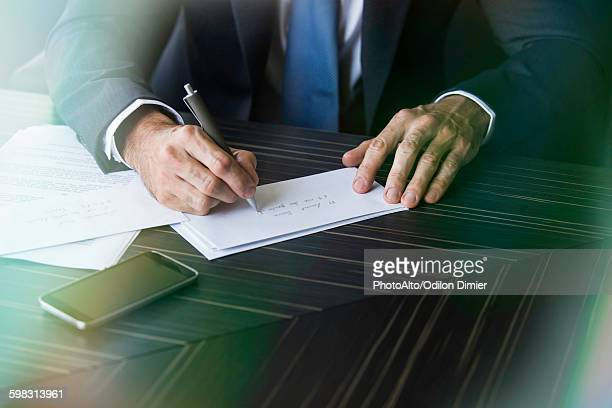 Lawyer addressing envelope