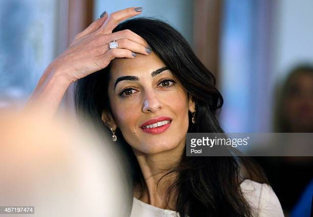 Lawyer Amal Alamuddin attends a meeting with Greek Culture Minister Kostas Tassoulas in Athens on October 14 2014 in Athens Greece Lawyers Geoffrey...